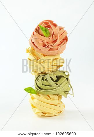pieces of tangled dry pasta stacked one on each other