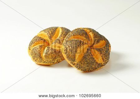 two fresh poppy seed buns on white background