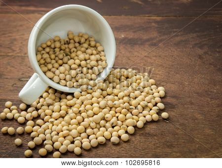 Soy beans on wood table.