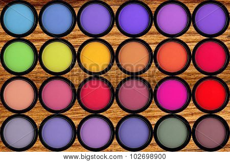 Colorful Eyeshadows In Black Boxes On The Wooden Background