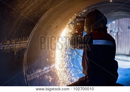Welder Carries Out Mechanical Cleaning Of Root Surfaces Of Weld Seam