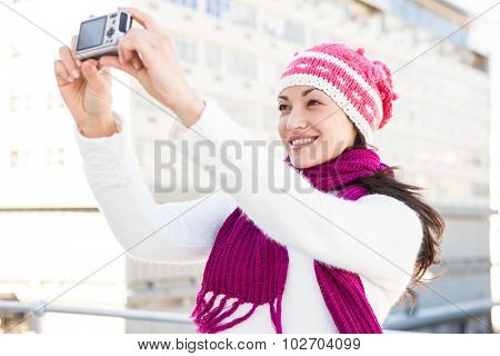 Happy woman taking a selfie outside