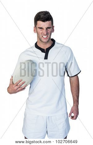 Portrait of an angry rugby player over white background