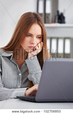 Bored Young Business Woman Working With Laptop.