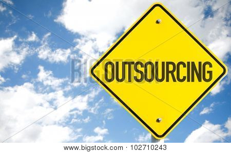 Outsourcing sign with sky background