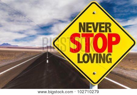 Never Stop Loving sign on desert road