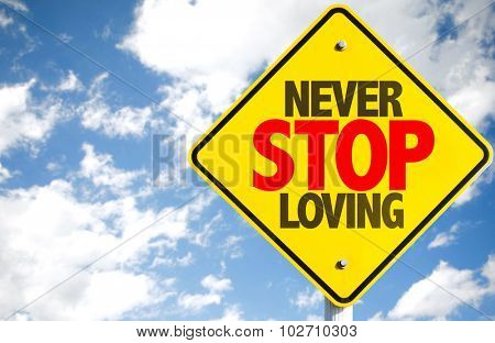 Never Stop Loving sign with sky background