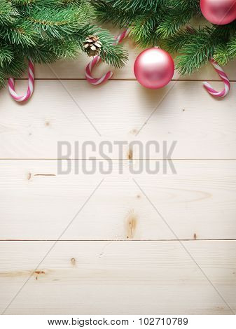 Christmas decoration with fur and baubles on old wood.