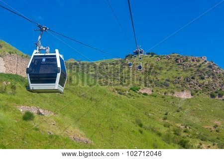 Funicular on green valley