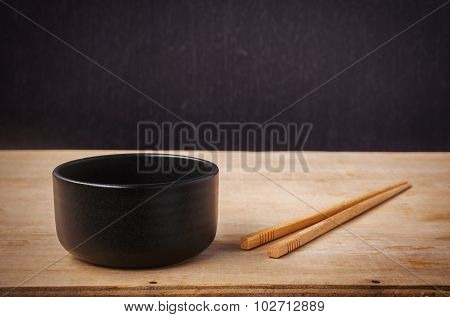 Still Life Black Bowl With Wooden Shopsticks