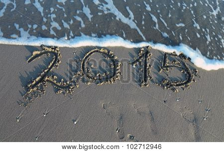 Inscription Year 2015 In The Sand Of The Sea With Waves