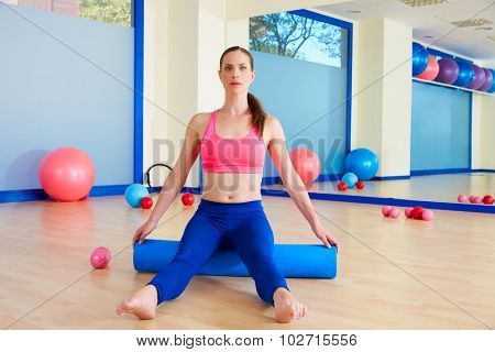 Pilates woman roller sit roll exercise workout at gym indoor