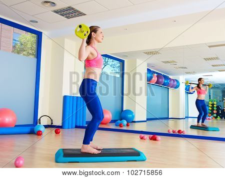 Gym woman barbell squats exercise workout at gym indoor
