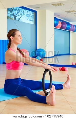Pilates woman spine stretch forward magic ring exercise workout at gym indoor
