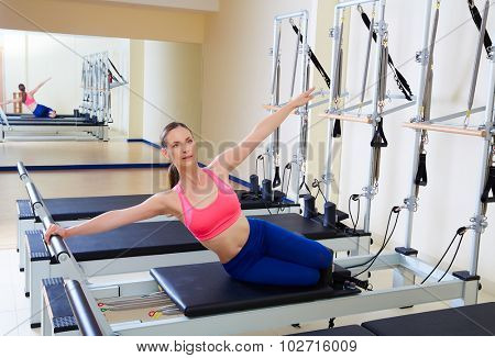 Pilates reformer woman mermaid exercise workout at gym indoor