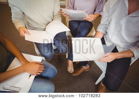 Low section of business people in meeting at creating office