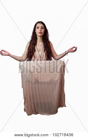 Portrait of beautiful woman levitating against white background