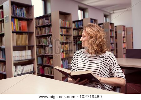 In The Library, Student Girl Or Young Woman With Books Thinking Of Something In Library.