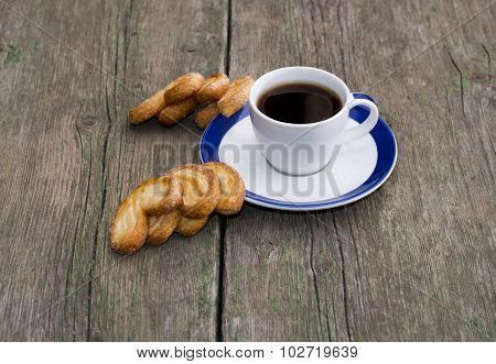 Cup Of Coffee And Two Groups Of Cookies On A Wooden Table