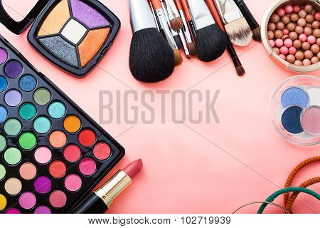 Cosmetics on pink background. Top view.