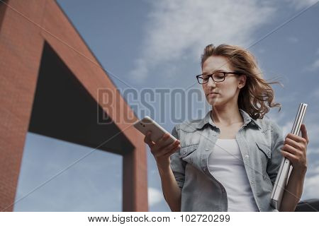 Young, Confident, Business Woman In Hurry.  Talking On Smartphone While Walking Down The Street