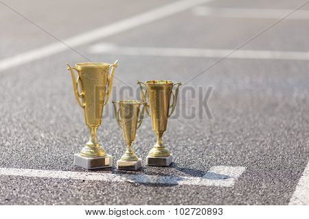 Cups winners standing on the pavement