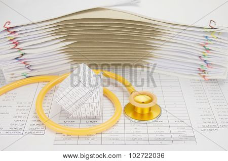 Bankruptcy Of House With Yellow And Gold Stethoscope