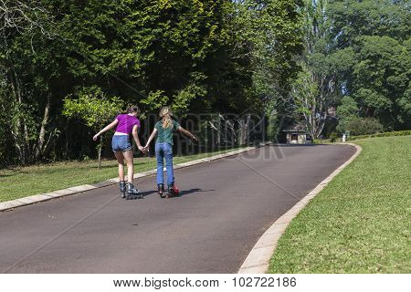 Girls Rollerblade Skating