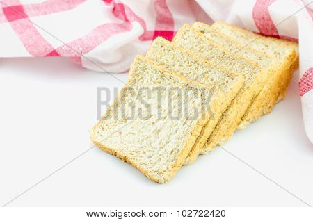 Slice Of Whole Wheat Bread With Red Napkin