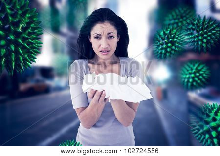 Sick brunette looking at camera against blurry new york street