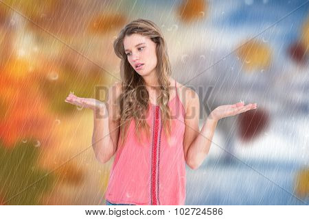 Unsure woman gesturing do not know sign against autumn turning to winter