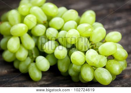 Green Grape, Close Up  On Old Wooden Table. Background. Selected Focus