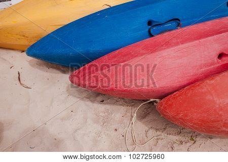 Colorful kayaks on beach in Thailand
