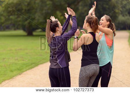Happy Women Relaxing After Outdoor Exercise