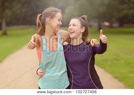 Healthy Woman At The Park Showing Thumbs Up