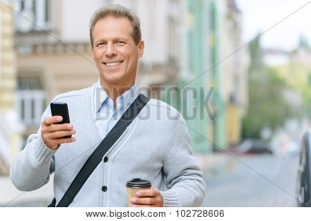 Pleasant man standing in the street