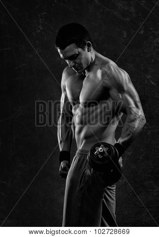 Young men, bodybulder working out with dumbbell