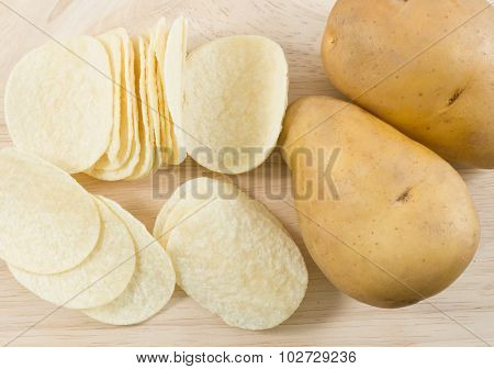 Top View Of Potato Tuber And Potato Chips Or Crisp