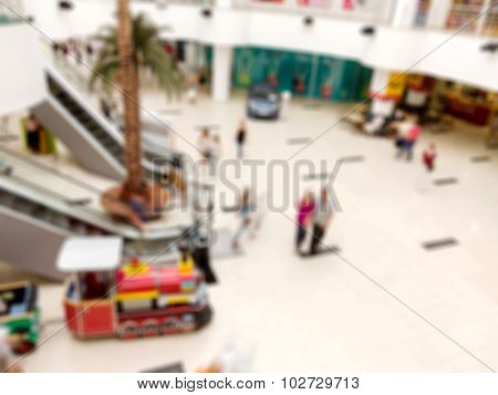 Blurred Image Of Shopping Mall And People, Bokeh For Background Usage.