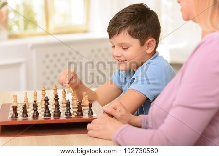 Grandma sitting at the table with boy