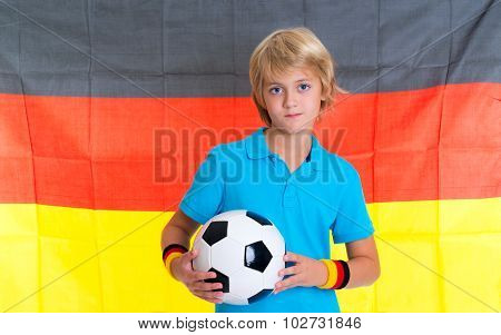 Boy With Soccer Ball In Front Of German Flag