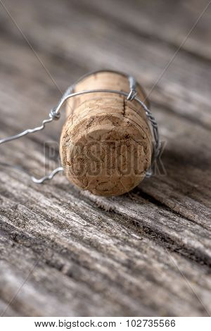 Champagne Cork Lying On Wooden Boards