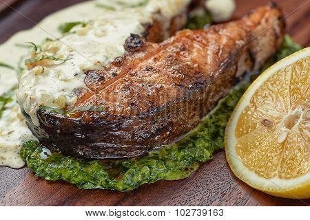 Salmon steak in cream sauce with lemon