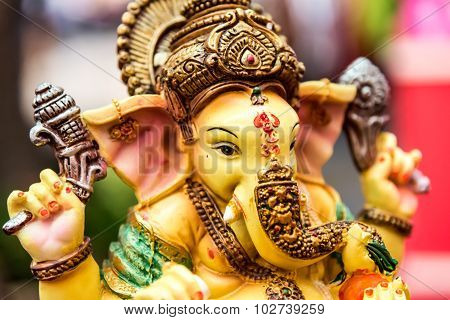 Yellow Rasin Ganesh Elephant God Statue Closeup Focused On Face