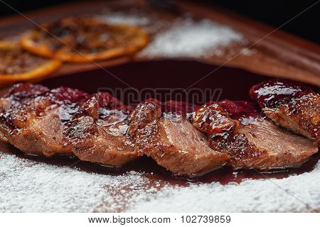 Baked spanish ham snack in sweat berry sauce