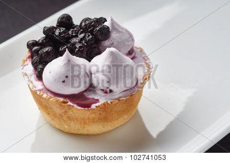 Beautiful cream Cupcake dessert with blackberry