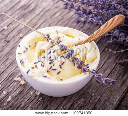 Herbal butter for breakfast with lavender flowers in a white ceramic cup