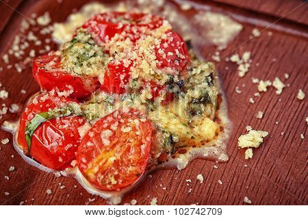 Salad of roasted tomato and cheese on desk