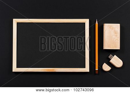 Wooden Frame With Black Field And Pencil And Usb Flash Drive In Wooden Box On Black Paper. Mockup. R