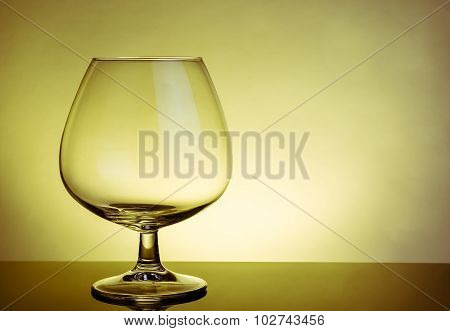 Empty Snifter Of Brandy In Elegant Typical Cognac Glass On Table
